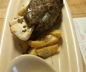 Whole roasted goat shoulder with lemon potatoes